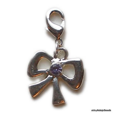 Bow charm with purple stone silver plated